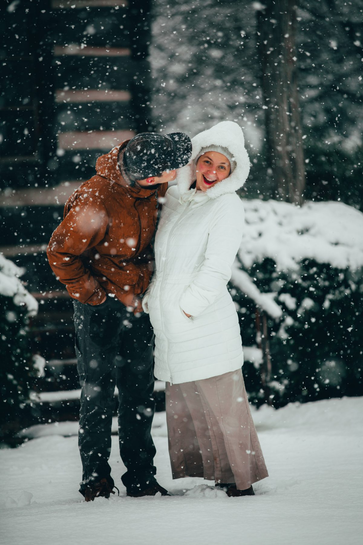 two people kissing in the snow