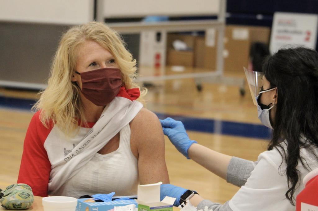 Tracey Schneeman, Ph.D, SHS Biology Teacher, gets her shot.